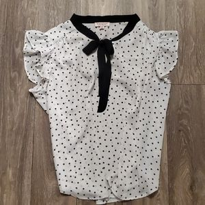 Polka dot blouse with bow accent
